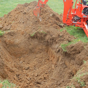 Excavator digs out a dry well or drainfield