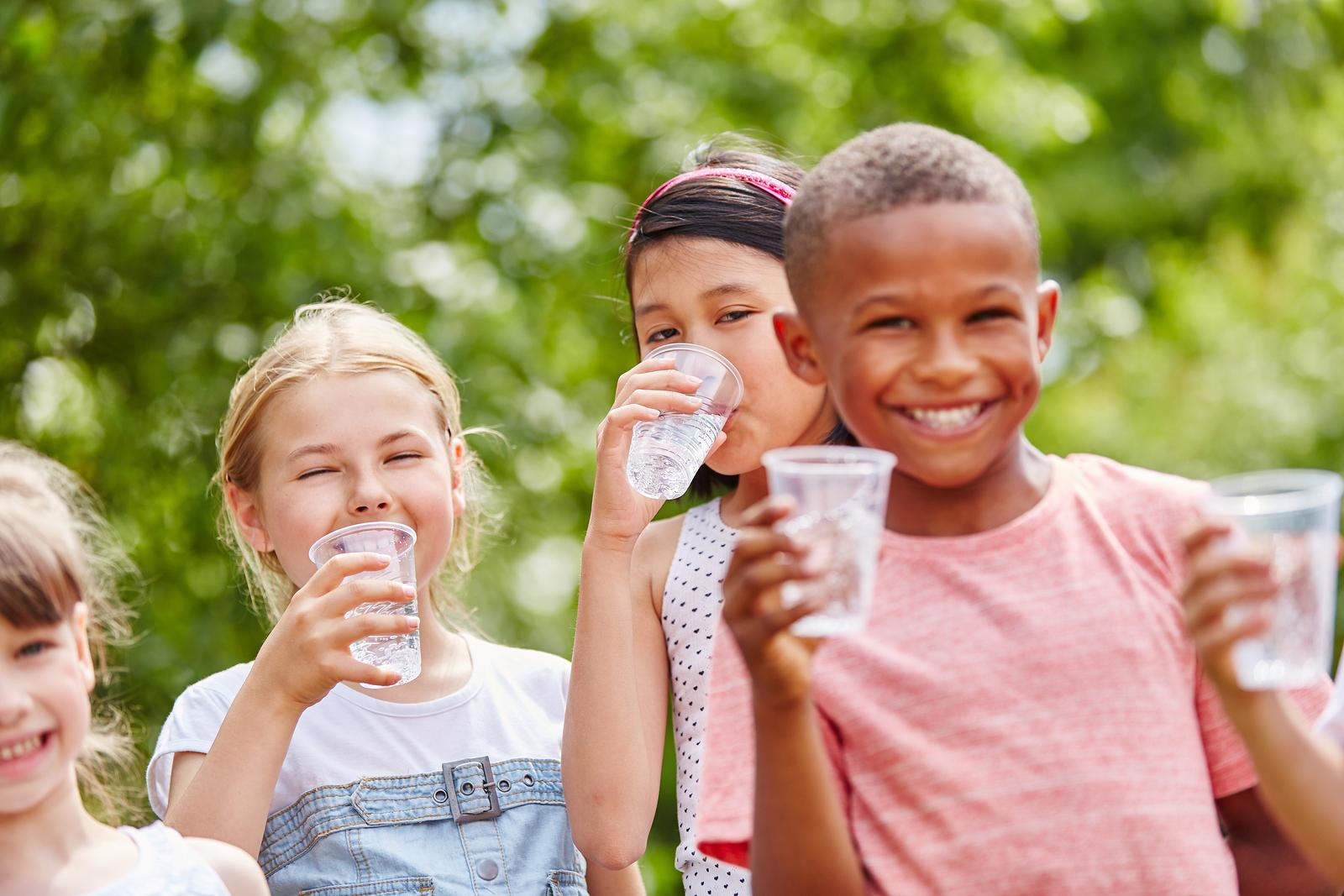 Happy children drink clean water